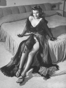 Famous photo of Rita Hayworth wearing a negligee.